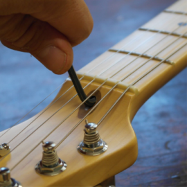 Truss rod adjustment at Headstock